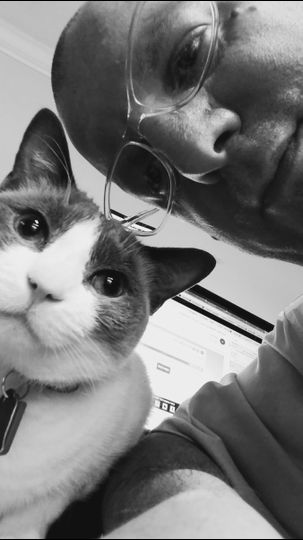 """DJ Rob Alberti with his office assistant """"Ember"""""""