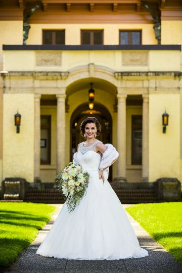 Bride in front of lord mansion