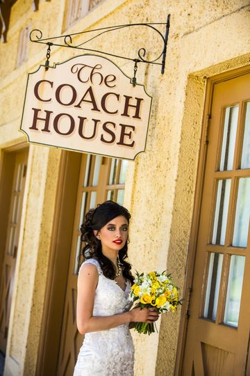Bride in front of Coach House