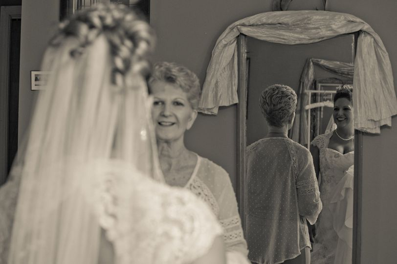 A mom looks on as her daughter readies to walk down the aisle. Grace Valley Farm, Shelbyville, Tenn.