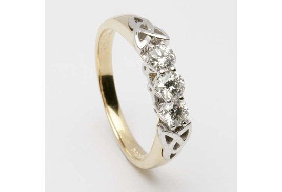 Stunning three stone dimaond engagement ring with Inset Trinity Knot in 14K white and yellow gold or...