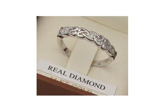 14K Yellow or White Gold Celtic Knot Ring. Three Single Cut Diamonds, 3 mm wide, total carat weight...