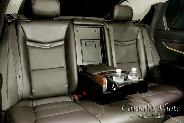 EL4 Black Cadillac XTS Sedan •Seats up to 4 Passengers •	http://www.exceedlimo.com/Vehicles