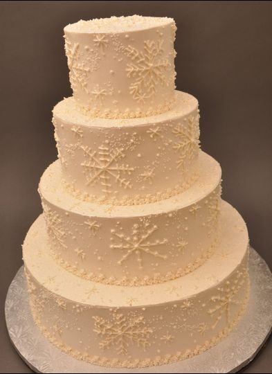 Buttercream wedding cake with snowflake details
