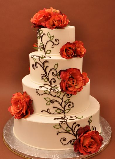 Floral wedding cake with chocolate detailing