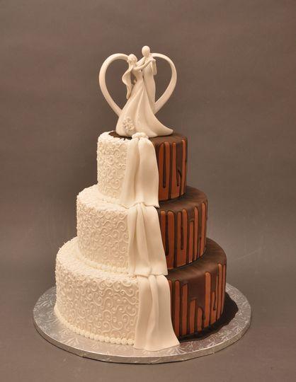 Vanilla and chocolate drip wedding cake