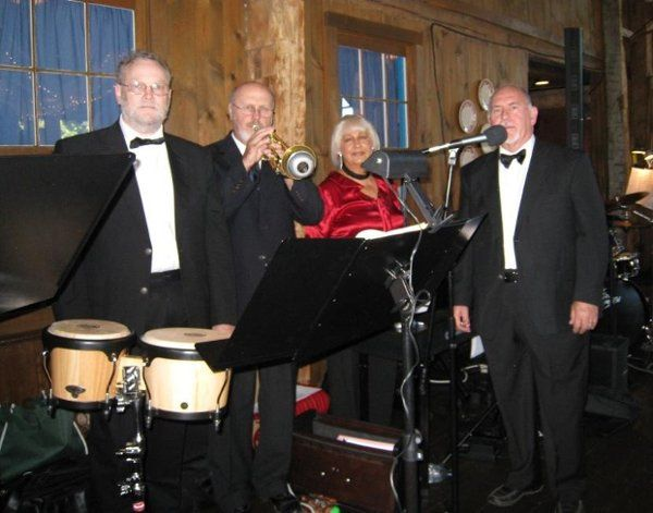 Jazz-Plus Combo plays at Amish Acres in Nappannee, IN. Phyllis on Piano, Tom Furness on Bass, Dave...
