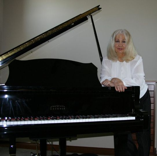 Phyllis Lynch at her Grand Piano