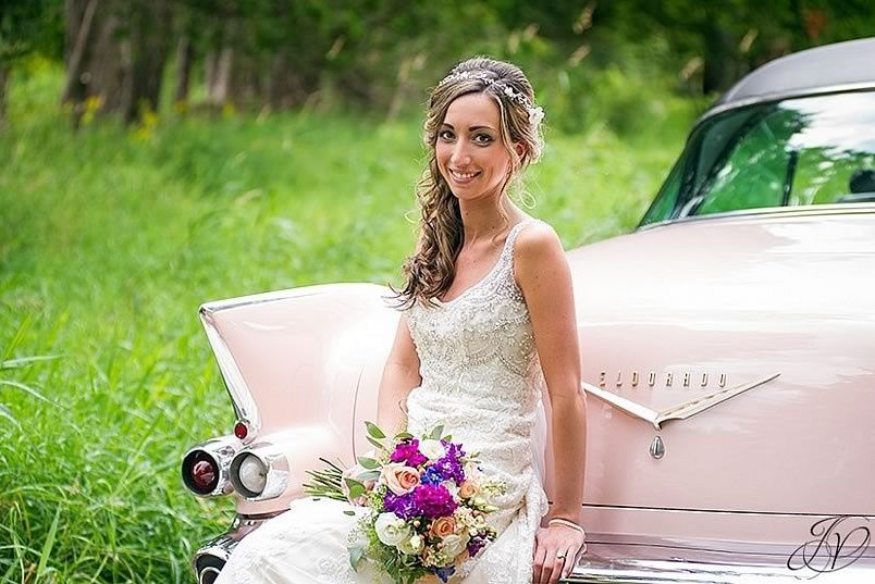 Bride sitting on her wedding car