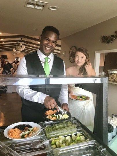 Bride and Groom enjoying award winning tacos
