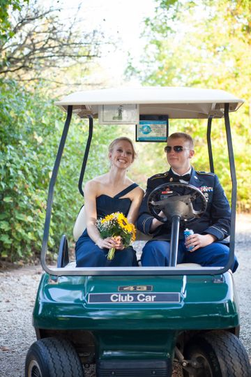 Couple ride's in golf cart