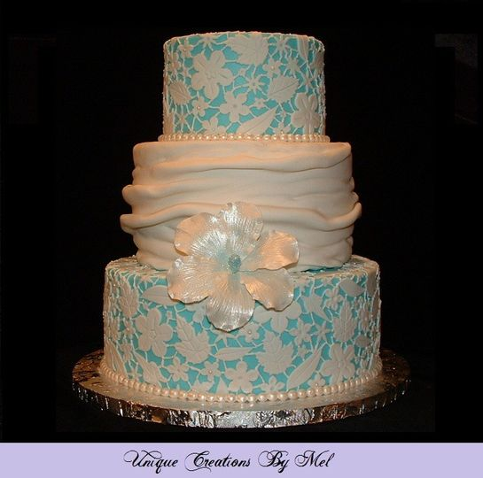 tier wedding cake with flower lace