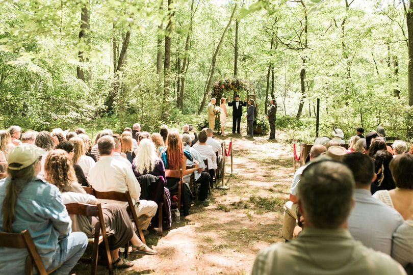 Forest ceremony with rental chairs from Event Rentals in Spartanburg.