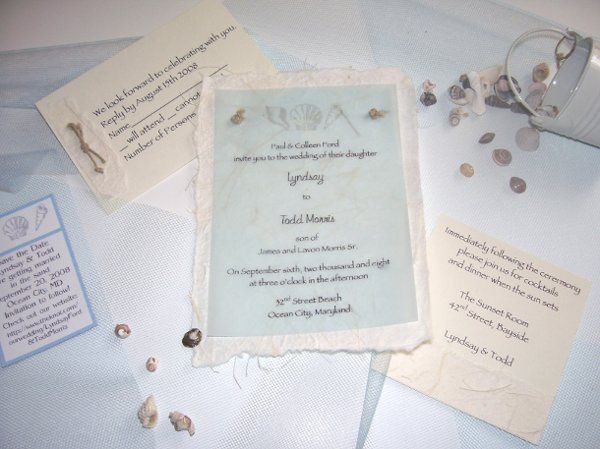 The Knot What a beautiful invitation for your beach wedding! The invitation is printed on a delicate...