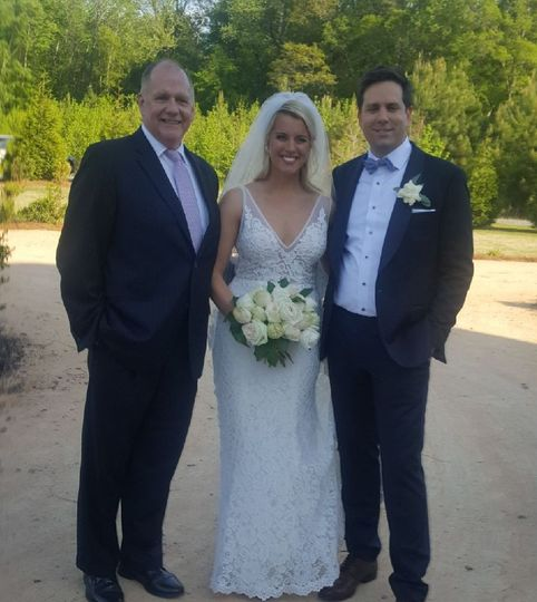 Sweet couple with officiant