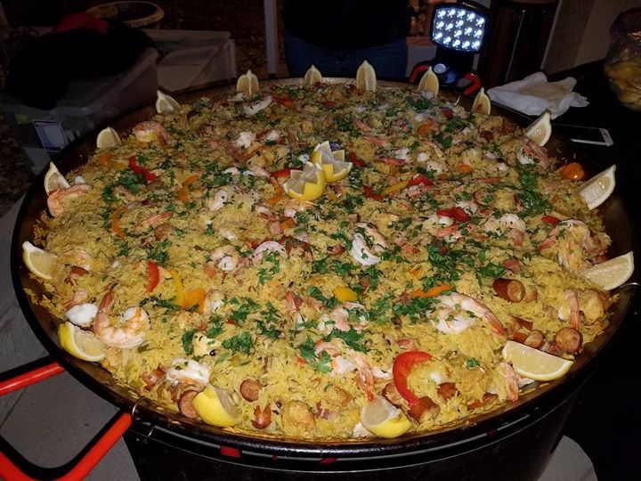 Paella topped with cheese