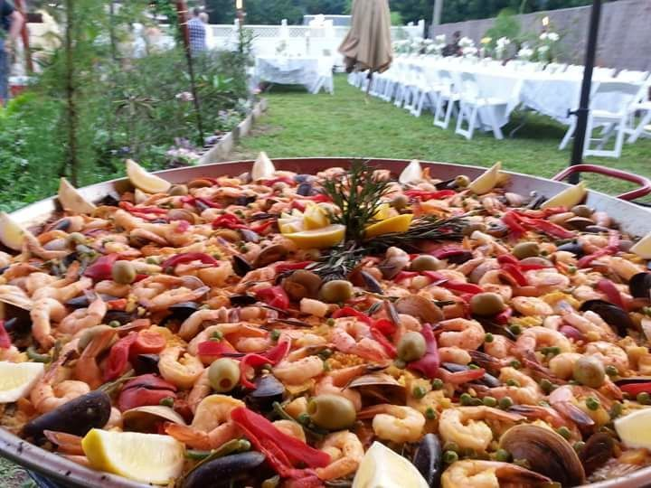 Paella topped with shrimp
