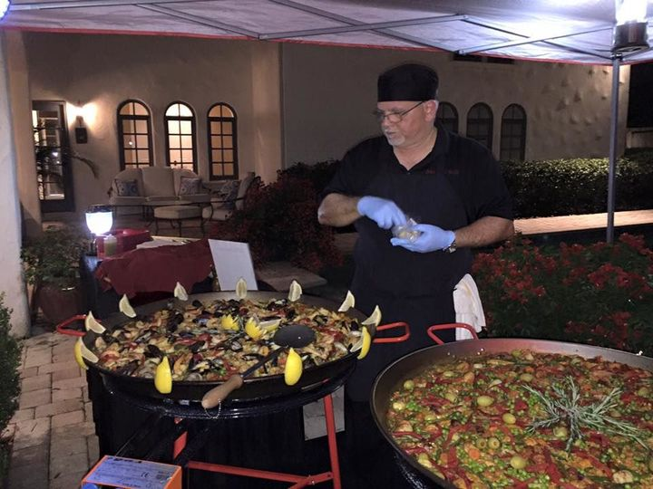 Chef preparing Paella