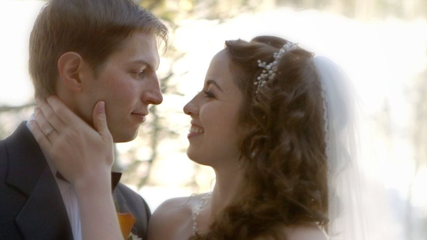 Screen shot from their wedding video at Snowbird Ski Resort in Utah