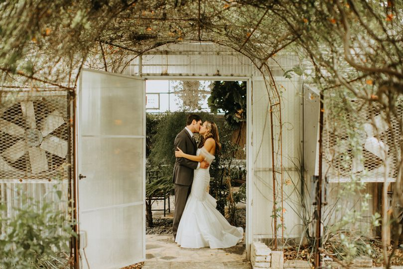 Newlyweds in a greenhouse
