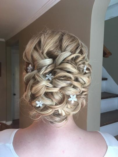 Wedding updo with silver accessories