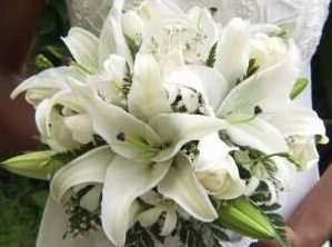 white lilies, statice, and greens