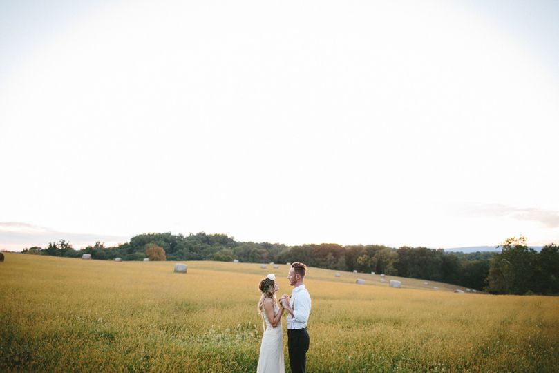 Couple by a wide open field