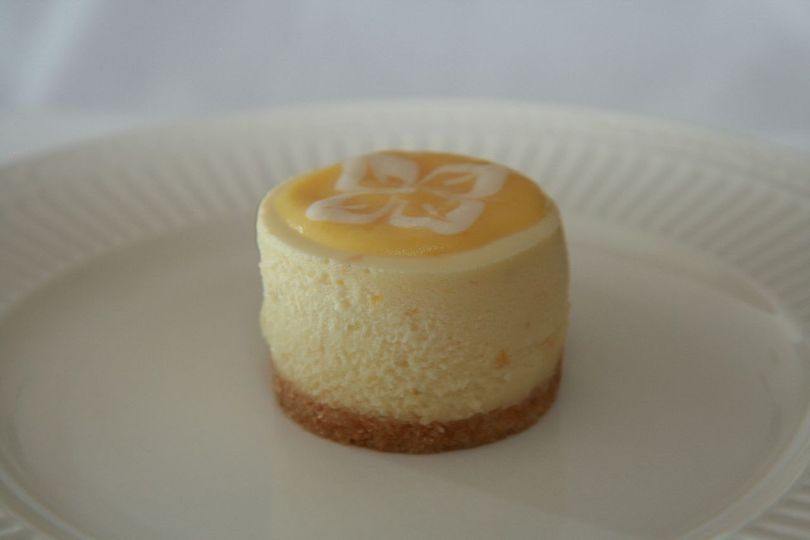 Triple Citrus Cheesecake - Creamy blend of Orange, Lemon and Lime, topped with Lemon Curd and...