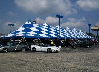 Specialty Tents, like this checkered tent, are great for a reception.