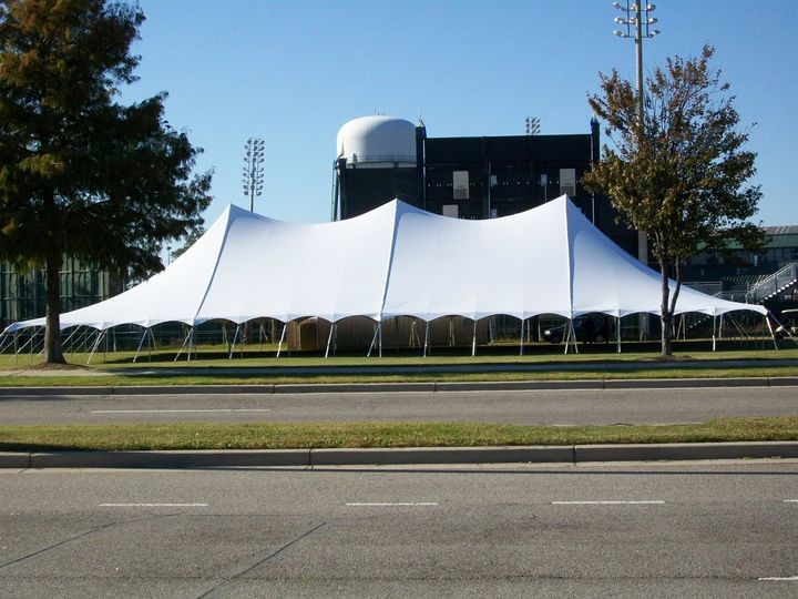 An elegant high peak wedding tent.