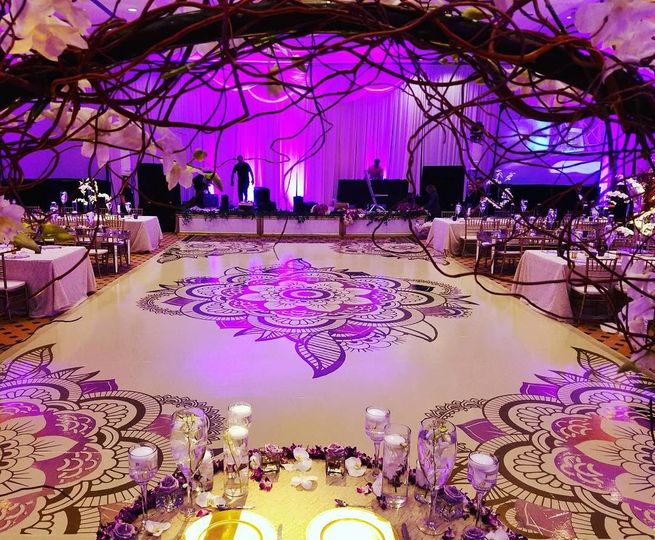 Reception space in pink uplighting
