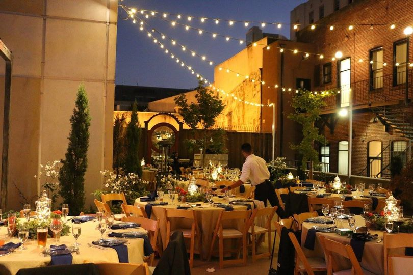 Beautiful surrounding architecture is a great background for this outdoor dinner.