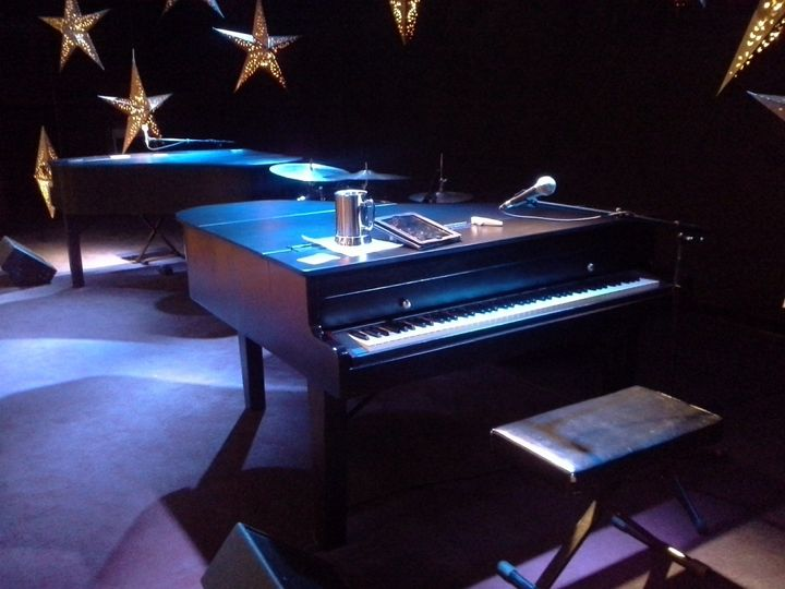 Close up of Dueling Hobbits Productions' St Louis Baby Grand Pianos