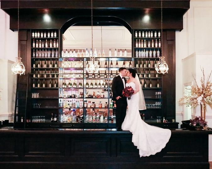 Kissing on top of the bar