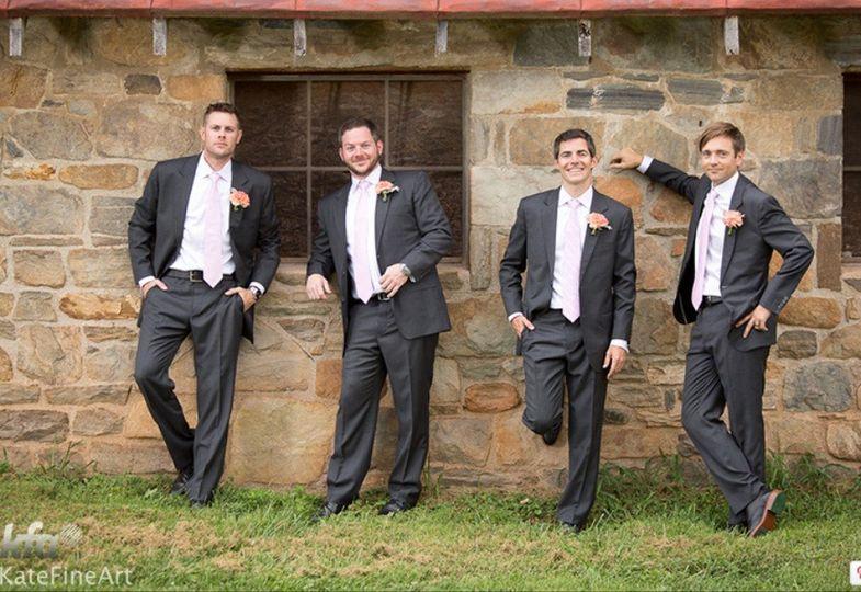 groomsmen on wall