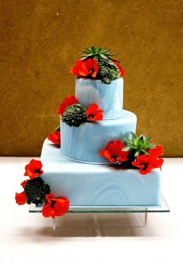Blue wedding cake with red flowers