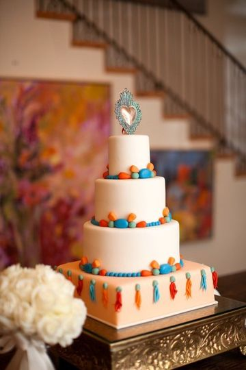 White three layered cake with colorful design