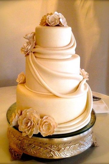 Simple wedding cake with drapes