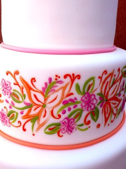 Pink three layered cake with floral design