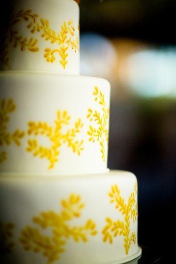 White cake with yellow design