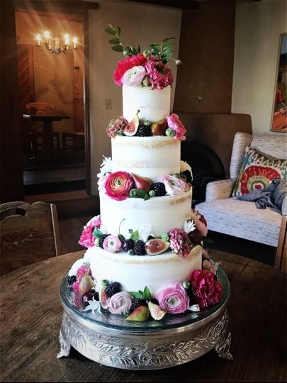 White wedding cake with pink tone flowers