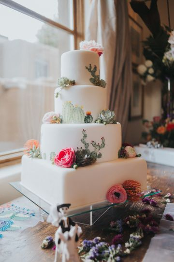 White cake with colorful flowers