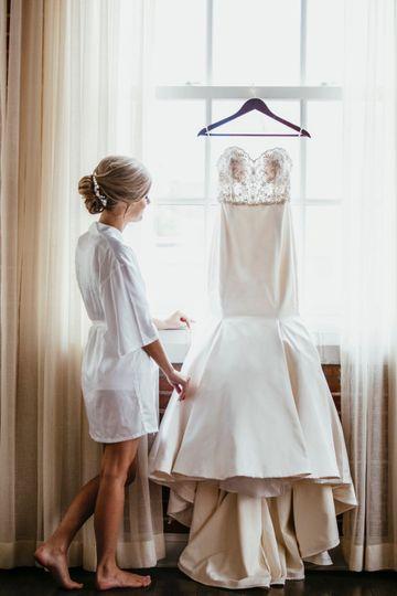 Bride examining her dress