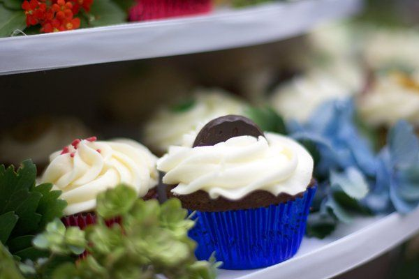 Close up of the cupcake tower featuring four flavors: Line, Chocolate Mint, Hummingbird & Red...