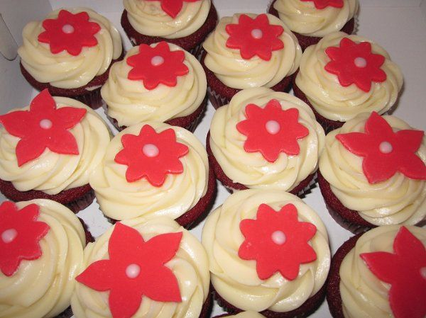 Red Velvet cupcakes topped with fondant red flowers.
