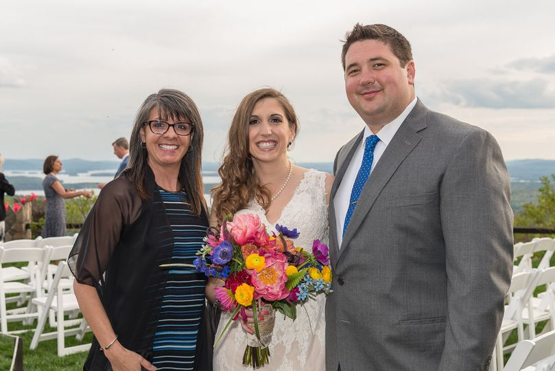 Happy newlyweds with officiant