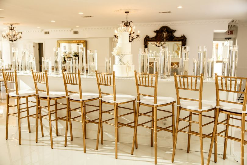 Golden High Chair With White Linen Long Table Set Up