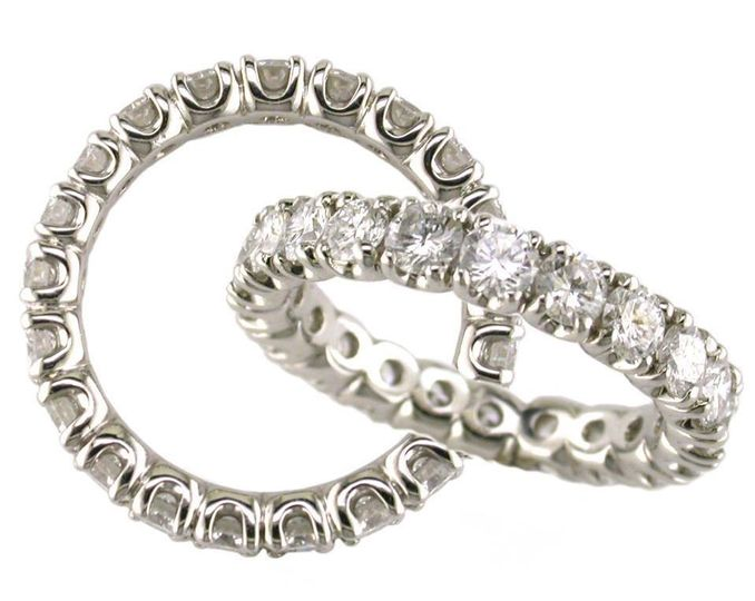 Round brilliant cut diamonds in our prong set eternity band, in 18k white gold or platinum