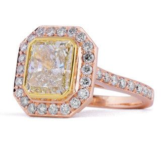 Bezel set fancy yellow radiant cut diamond engagement ring in rose and yellow gold, with diamond...