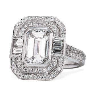 Engagement ring with an emerald cut center and baguette and micro pave detail.  Total Carat Weight:...